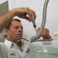 man fixing equipment