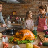 family of four around kitchen counter